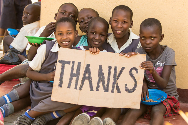 Kids with Thanks sign