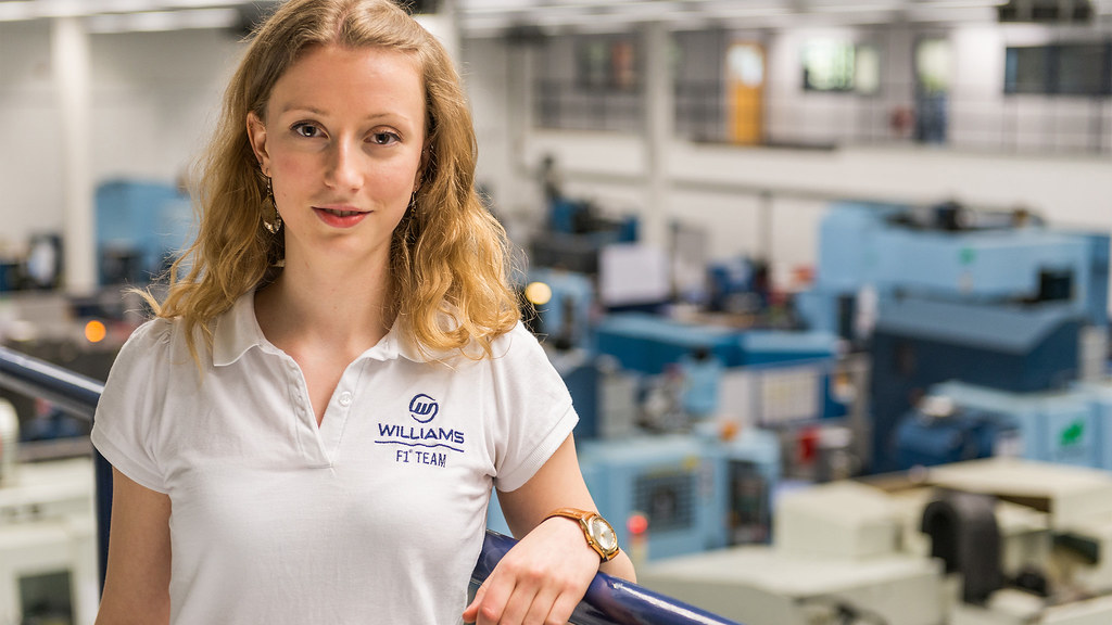 A student on placement at Williams F1 looks forward in front of a factory floor