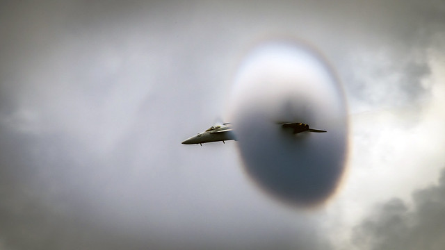 An F/A-18E Super Hornet conducts a high-speed flyby during an air-power demonstration.