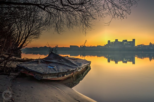 A boat, a river and a sunrise