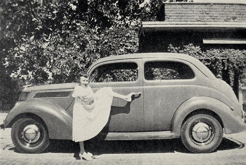Mary Belle de Vargas opening the door of an automobile