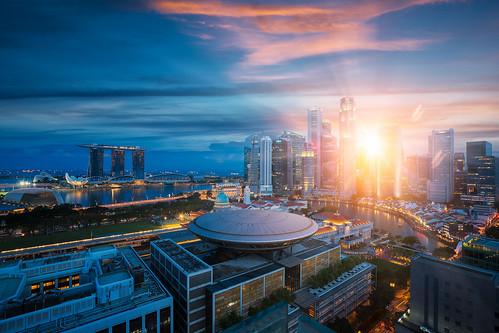 Singapore city with sunrise by day to night photo | by anekphoto