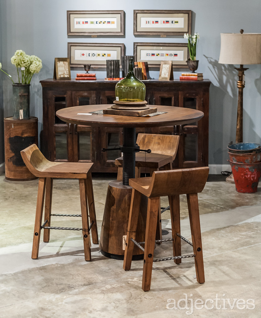 Vintage wood crank table and wood bar stools at Adjectives Altamonte