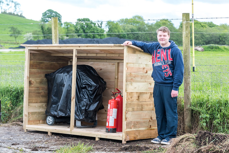 Nathan with the shed he made for our barbecue, fire extinguishers etc.