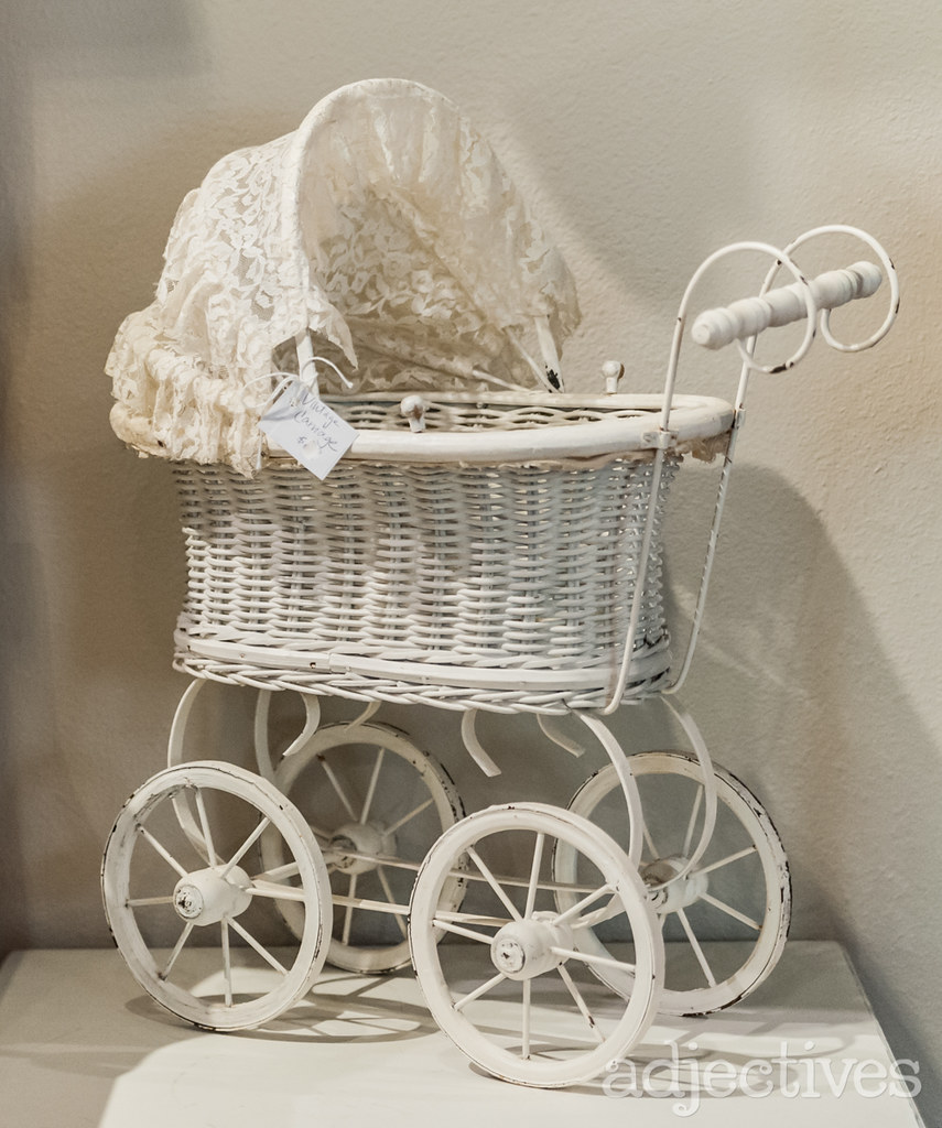Vintage White Babydoll Stroller by Blue Bird Cottage at Adjectives Winter Garden