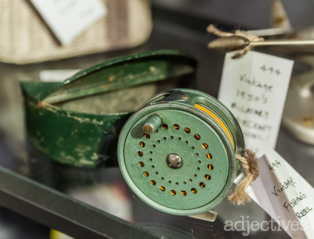 Antique fishing reel and antique tackle box by Bella Fine Art at Adjectives Winter Park