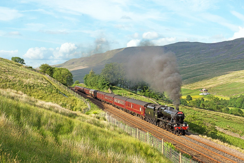 With the fireman luckily doing his business at an opportune time in the mid-twenties temperature, 48151 is well into the hard climb to Ais Gill summit at Angrholme, running some thirty minutes down. The 1Z46 16:36 Carlisle to York 'Dalesman' charter on Monday 19th June 2017.  Copyright Gordon Edgar  - All rights reserved. Please do not use any of these images without my explicit permission