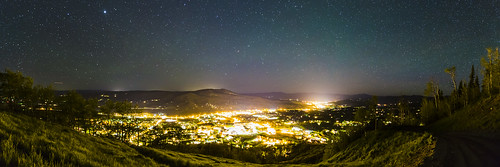 astronomy night sky stars dark bright landscape trees forest woods grass light city town path slope trail mountains peak colorado steamboatsprings yampavalley glow panorama longexposure