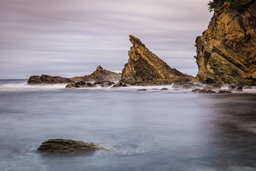 simpsonbeach ocean rocks cliff boulders longexposure oregon shoreacrespark
