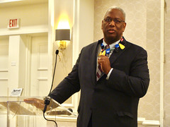2017 Equality Breakfast - Congressman Donald McEachin auctioning off a necklace to support LGBT Democrats of Virginia