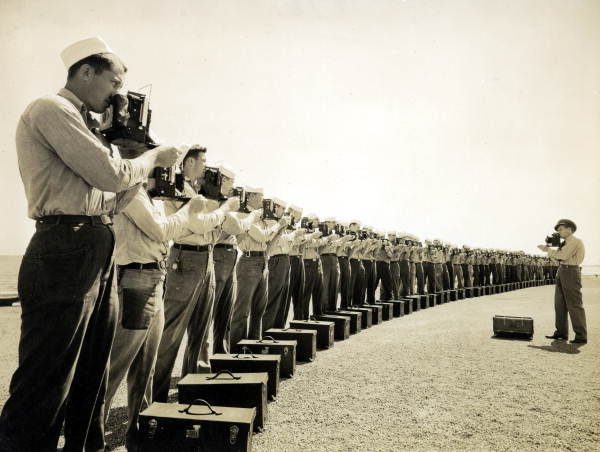 Naval Photography School instructor teaching camera techniques to class at NAS Pensacola