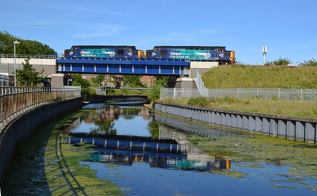DRS Locos 37059 & 37069 on 6M69 Sizewell to Crewe Coal Sidings, with a single empty flat wagon, crossing the River Gipping in glorious sunlight. 14 06 2017