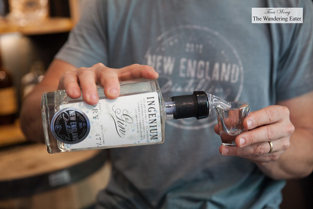Tom pouring the brand's first spirit, gin