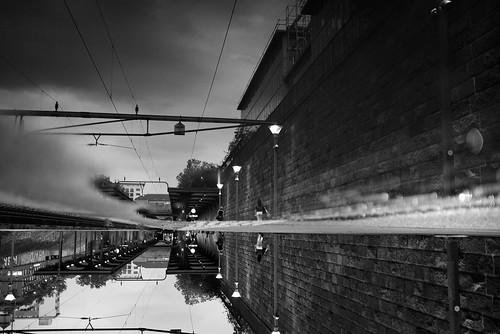 zürich switzerland wiedikon 2017 bw noiretblanc reflection puddlegram pointofview pov publictransport sbb woman fujifilm x100t streetphotography