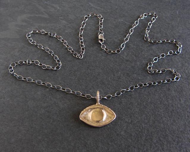Evil eye pendant in bronze