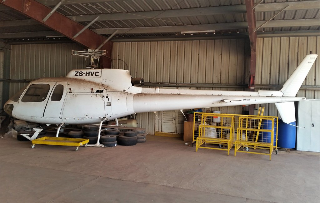AS-350B Ecureil ZS-HVC (c/n 1129) All white c/s. Stored, Bamako-Sénou. Mali. December 2014.