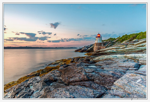 ri sunset sky lighthouse clouds landscape rocks rhodeisland newport sentinel flickrelite cloudsstormssunsetssunrises