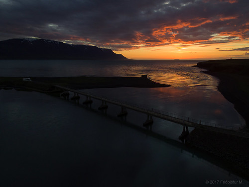 northwesternregion iceland sauðárkrókur tindastóll seascape bridge héraðsvötn sunset clouds recreationalvehicle rv dark reflection sky coppercloudsilvernsun ísland djiphantom friðþjófurm drangey landscape landslag car
