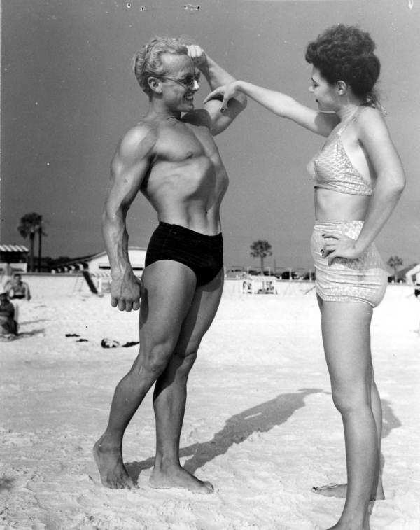 Phil King shows his muscles to Leatrice Jackson, of Hueytown, Ala. - Panama City Beach