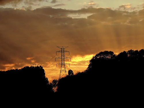 tower power electricity highvoltage transmission wires sunset clouds orange radiant dusk evening pennsylvania fayettecounty wheeler silhouette hillside hilltop nature outdoors light rays