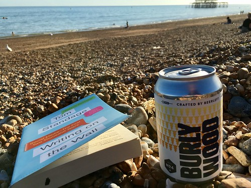 On the beach with a book and a beer. | by adactio