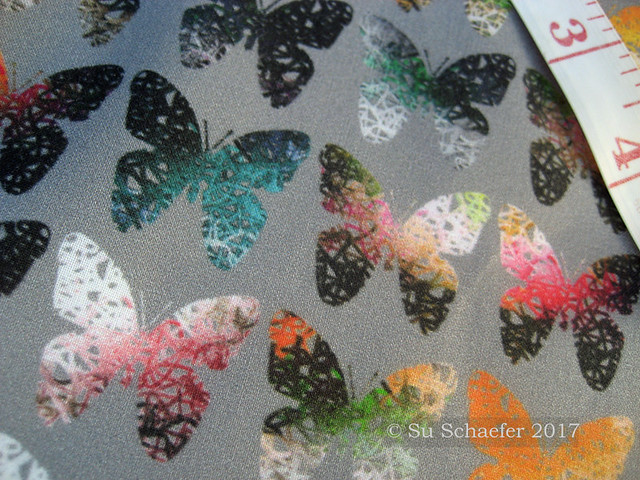 'Dark stark orange butterflies on gray by Su_G': close up on basic cotton