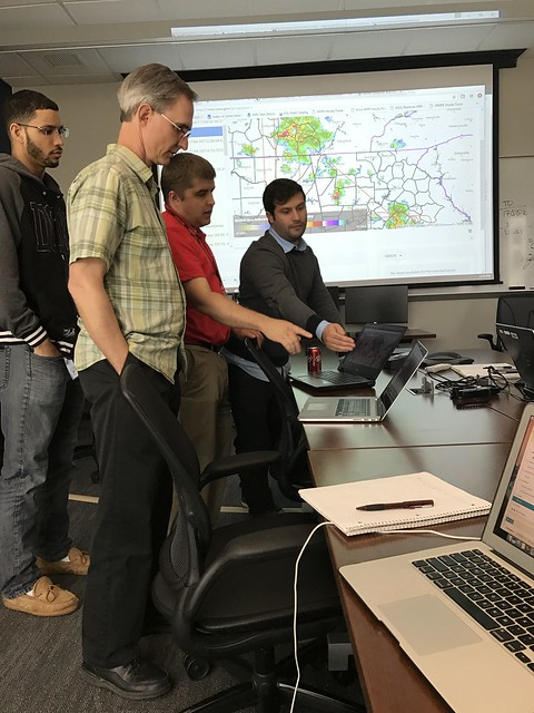 Forecasters Review Weather Data during Lightning Mission