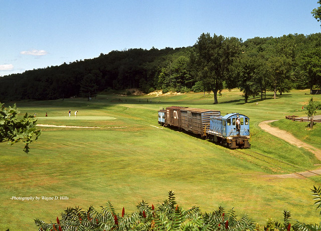 B&M Alco S3 No. 1178 and train passing through the Thomas Memorial Golf Course in Montague, Mass. on the Turners Falls Branch, July 22, 1977