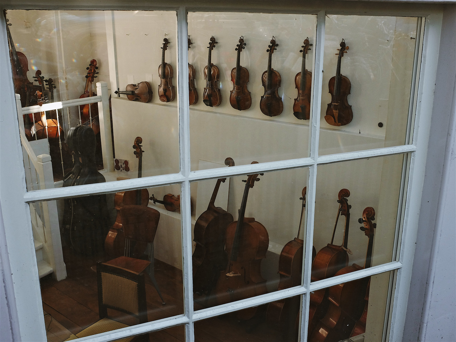 Violins and cellos seen through a window