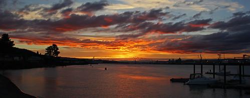 sunset sundown red columbiariver water docks oregon clouds reflections boats rainieroregon lewisandclarkbridge