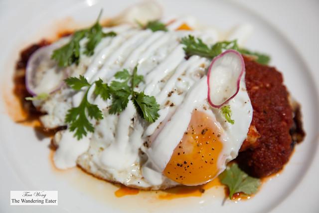 Chile relleno with pork belly, queso blanco, salsa roja, crema, sunny eggs