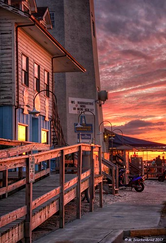 deweybeach delaware de sunset lighthouse rehobothbay atlanticocean seafoodrestaurant pub livemusic sussexcounty coastaltown sand beach