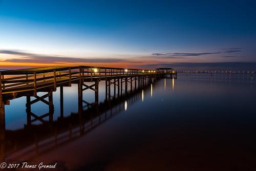 lights bluehour sunrise pier water reflections fishingpier safetyharbor dawn orange oldtampabay