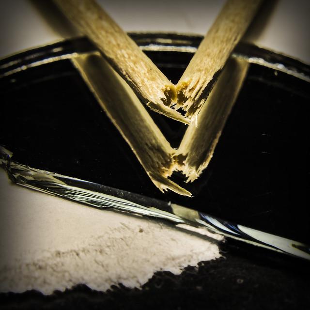A toothpick broken on a broken mirror on broken paper