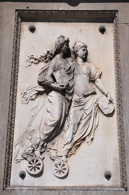 """Barcelona. Allegory of the """"Compañía de los Caminos de Hierro del Norte de España"""". Relief on the Monument to Antonio López y López. 1884. Joan Roig i Solé, sculptor"""