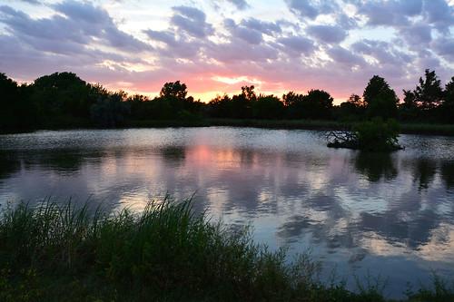 sunset water reflection clouds chisholmcreekpark wichita kansas