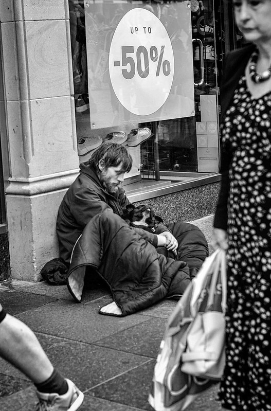 Beggar walk by