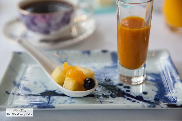 Mango, tumeric smoothie and fruit salad
