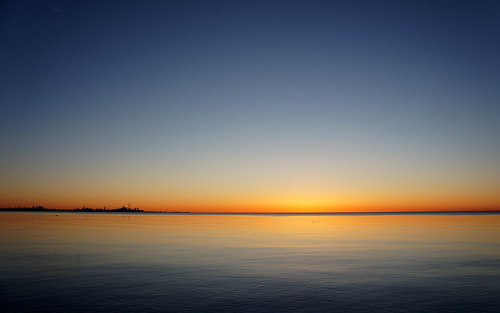 lake sunrise blue orange colours calm early toronto cityscape landscape ontario morning