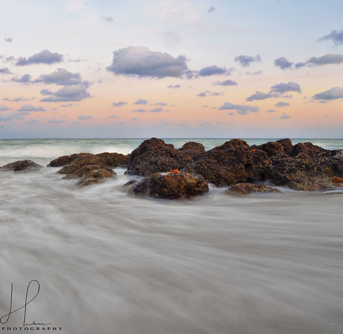 beach water florida floridaphotography colorful calm clouds bocaraton rocks long sea ocean sand southflorida longexposure longexposurephotography redreefpark floridasbeaches daytime sunset breathtakinglandscapes