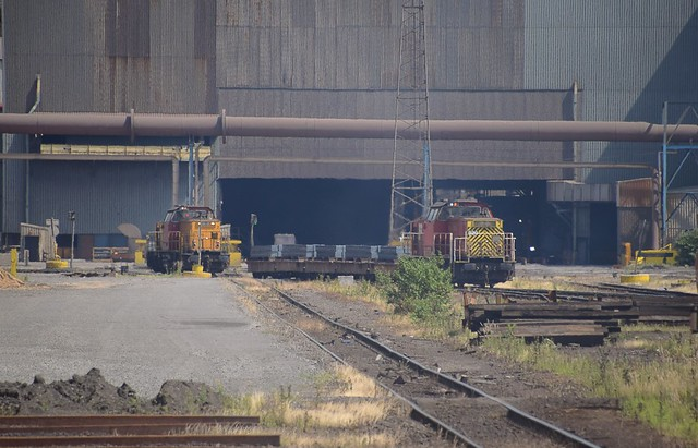 Maschinebau Kiel (MaK) Bo Bo Loco No 820 (8.720) waits with a load of steel billets whilst No. 8.719 approaches to assist at the rear, away from the Continuous Casting Plant in the background. British Steel, Scunthorpe. 08 07 2017