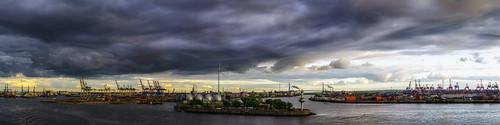 panorama hamburg germany cityscape harbour elbe river cranes clouds dark sky