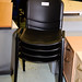 Black plastic stacking chairs E30