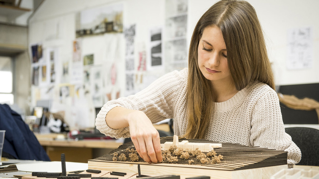 A student works on her project model in our design studios in 6 East.