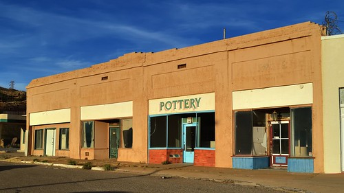 nikond3200 edk7 2013 us usa arizona cochisecounty bisbee lowell ghosttownheritagedistrict old vintage classic architecture building oldstructure city cityscape urban store storefront vacant abandoned shop brick signage door window stucco adobe sky cloud sunset