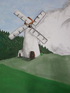 Detail větrného mlýnu na malbě, kterou vytvořili moji spolužáci (Daniel Lojda, Daniela Vaverková)