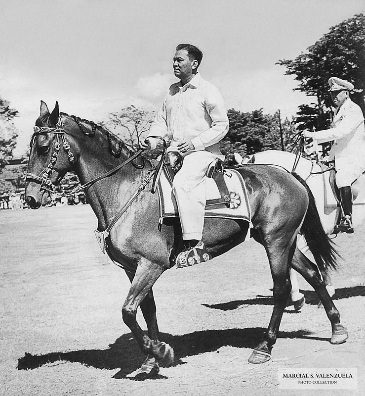 President Magsaysay riding his horse, Victory.