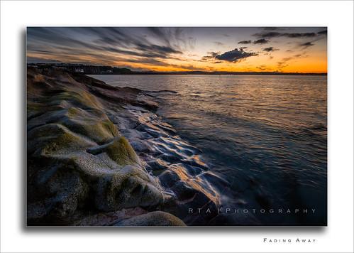 brixham torbay southdevon devon rtaphotography glow sunset dusk sky sea bay water shore rocks colours clouds