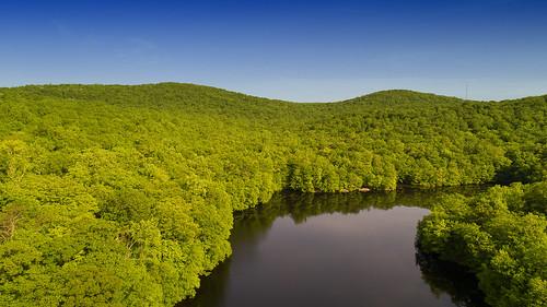 mahwah newjersey unitedstates ramapo nj dji drone pro plus lake trees forest sring sky blue mountains phantom