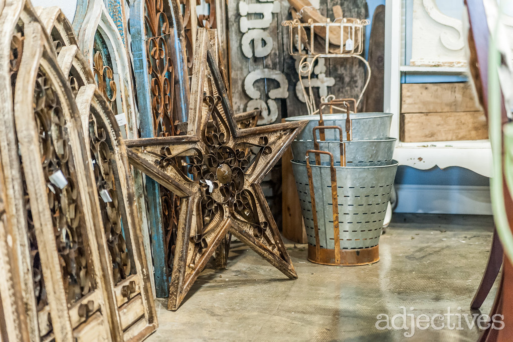 Wood/metal decor and olive buckets in Altamonte by Uncle Mike